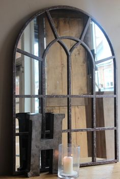 STEEL WINDOW FRAME MIRROR - antique looking mirrored panes to brighten a hall or room.