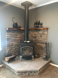 Corner wood stove fireplace with juniper mantel in lounge room Wood Stove Decor, Wood Stove Wall, Wood Stove Surround, Wood Stove Hearth, Stove Fireplace, Wood Fireplace, Wood Burner, Corner Log Burner, Wood Burning Stove Corner