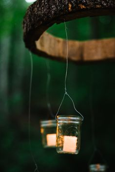 DIY Wood Chandelier - click to learn how to make this AWESOME outdoor wedding detail! Image by Fotos by Jeff. Tutorial by Real Southern Accents.