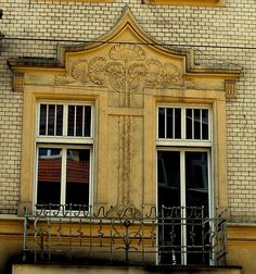 Katowice, Poland by T'ai Li, via Flickr  Detail above the windows...