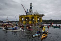 Activists in kayaks protest Saturday near the Polar Pioneer, Shell's giant oil rig, which is moored at the Port of Seattle's Terminal 5.  (Ellen M. Banner / The Seattle Times)