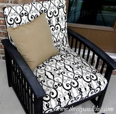 Recovering your outdoor cushions.  You can even use a decorative shower curtain in you want something that is water repellant.