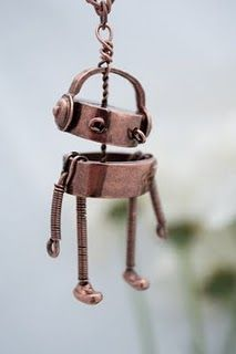 """Super cute robot necklace designed by Meg (from Meg & Dia). You may recognize Dia from NBC's """"The Voice""""- I think she wore it on the show too"""