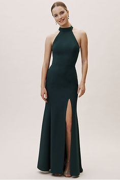 Channel your inner Meghan Markle with this sleek and sophisticated crepe dress featuring a high-neck and deep slit. This item is available for try-on in all stores; book an appointment at your local BHLDN shop.Only available at BHLDN Emerald Green Bridesmaid Dresses, Emerald Dresses, Wedding Bridesmaid Dresses, Bridesmaids, Forrest Green Bridesmaid Dresses, Bridesmaid Pictures, Wedding Dress, Valentino, Gown Photos