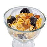 Homemade Muesli        3/4 cup organic oatmeal      3/4 cup seven-grain cereal (such as Kashi)      1/4 cup dried plums or apricots (cut into small pieces)      2 tbsp. unsalted mixed nuts      1 tbsp. shredded coconut      1 tbsp. pumpkin seeds      1 tbsp. sunflower seeds      2 tbsp. unfiltered, unprocessed honey      1 1/2 cups plain yogurt