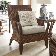 Temani sports a sturdy mahogany-and-pine frame clad in natural, hand-woven rattan with a glossy lacquered finish. A wide, gently curved back and flared rattan pole armrests leave plenty of wiggle room. Personalize it with your favorite cushions and pillows. We know where you can get some.