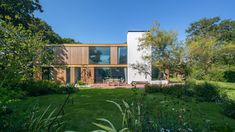 Woodpeckers, New Forest, UK | Strom Architects. Side elevation. Contemporary, one-off house, inside/outside living, larch cladding, garden view, modern, architecture, trees.