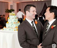 Phil & Shawn pause for a private moment near their wedding cake by Cheryl Kleinman.  www.celebrationsbykat.com