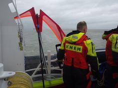 Kitesurfer en materiaal aan boord