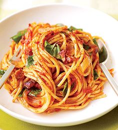 This 20-minute recipe features pasta in a bacon and basil tomato sauce. Use any strands of pasta you have on your shelf--spaghetti, angel hair, or linguine.