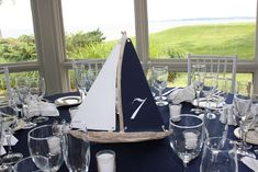 driftwood sailboats used for table centerpieces at nautical wedding.