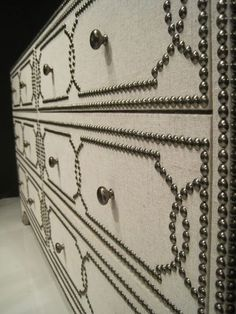 upholstered nailhead chest.