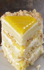 Lemon Coconut Cake Recipe - Tangy lemon filling between layers of tender white cake. Top it all off with a rich coconut-cream cheese frosting. Some people think that it is the best cake they've ever eaten. Lemon Desserts, Lemon Recipes, Just Desserts, Delicious Desserts, Dessert Recipes, Lemon Cakes, White Cake Recipes, Layer Cake Recipes, Best Cake Recipes