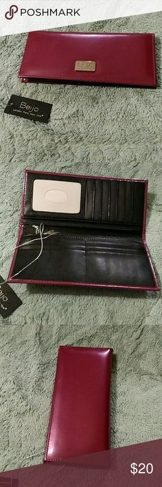 Beijo Shiny Pink Wallet NWT Super fast shipping! Make me an offer! No reasonable offer refused. Always discounted bundles of 2 or more. Beijo Bags Wallets