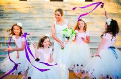 multiple flower girls with ribbons