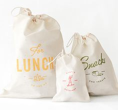 link to:  $10 muslin string tie reusable snack bags, embellished with retro typography (I love all the polka dot stuff the model is wearing, too)