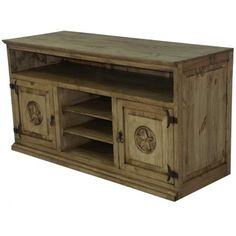 """Rustic, solid wood and heavy! Watch your favorite shows atop this rustic beauty. See all the TEXAS STAR pieces. """"Color may vary slightly"""". A Tres Amigos favorite. Dimensions: 61"""" l x 32"""" h x 24"""" w."""