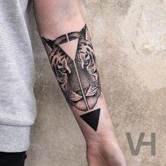 split tiger face tattoo