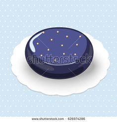 Picture of mousse cake with fruit filling decorated by gold balls on the glossy glaze.The cake is on the blue polka dotted background.