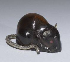 Faberge Mouse,  Peter Carl Fabergé (Artist) House of Fabergé (Manufacturer)  smoky quartz, diamonds, gold, rubies.1 5/16 x 1 9/16 x 2 3/8 in. (3.4 x 4 x 6 cm).