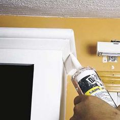Livelovediy how to paint kitchen cabinets in 10 easy for Caulking kitchen cabinets