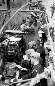 "Generaloberst, Heinz Wilhelm Guderian,  Southern-France, stands in a medium armored car. (Sd.Kfz 251/3), radio operators (foreground) decrypt codes with an ""Enigma"" encryption machine.  VERY high-tech."