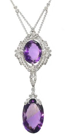 This is a gorgeous 14k white gold necklace inspired from the Edwardian period. The pendant is centered with impressive oval cut amethyst weighing approximately 28.16ct.