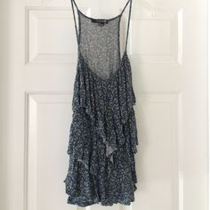 Floral tank spaghetti strap. Blue, purple and green floral print tank top. Cute ruffles in the middle Forever 21 Tops Tank Tops