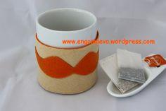 For coffee or tea hot without getting burned. Handmade gift. Design mustache, beige and orange   ----   Para tomar el café o té,  bien caliente sin quemarnos. Regalo artesanal. Diseño bigote, beige y naranja.