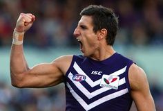 Be at the MCG to watch the inspirational captain of the Fremantle Dockers lift the Premiership Cup as they win their first ever Grand Final. Football Team, Cool Designs, Tank Man, Menswear, Boys, Mens Tops, Bucket, Inspirational, Club
