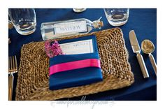 Love the navy napkin with the pink detail at the place setting