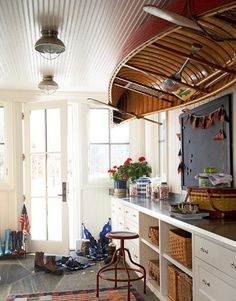 Mudroom with Rowboat on the Ceiling over Worktable