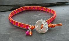 Orange and hot pink leather beaded bracelet with silver button £10.00
