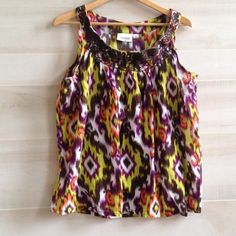 Gauzy multi colored sleeveless blouse Embroidery along neck line. Circle neck.  Tag says 14/16 Avenue Tops Blouses