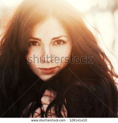 Outdoor fashion stunning closeup portrait of pretty young girl. Woman posing in winter sunny sunshine photo. - stock photo