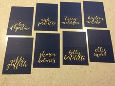 Place cards with GOLD hand lettering in a modern calligraphy font, from Lock + Keep. Other colors available include: navy, white, light gray, dark gray, black, craft brown, plum, and blush.