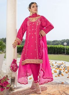 If you are looking to attend an intimate event in a sophisticated yet stand alone ensemble, this is it! A beautiful shade of magenta pink with a lovely Tratiional back and front neckline is completely hand embellished with zardozi, French knots, Gota and sequence along with subtle aari single dhaaga thread work. The knee length cut of the shirt adds flattering length and style for any age and shape! Additionally an embroidered silk dupatta adds oomph to the look! Dress it up with some… Asian Wedding Dress Pakistani, Beautiful Pakistani Dresses, Pakistani Fashion Casual, Indian Fashion Dresses, Pakistani Outfits, Indian Outfits, Stylish Dresses For Girls, Casual Dresses, Embroidery Suits