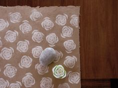 handmade wrapping paper. the heart of celery sliced and used as a homemade stamp. use white ink pad on brown kraft paper.