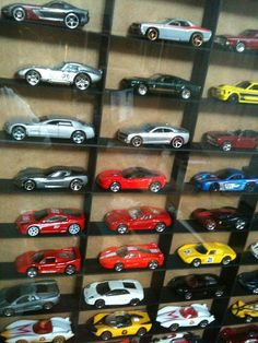 Shadow Box Display for toy cars!  Brilliant.  Frame by IKEA and grid material from Michaels.