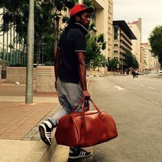 Red Oker handmade leather overnight bag on the streets of joberg Leather Overnight Bag, Liquid Gold, Leather Bags Handmade, Other Accessories, Action, Wallet, Red, Beautiful, Group Action