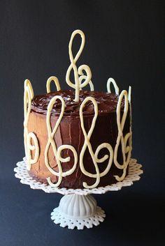 Yellow cake with swirls of chocolate filled with chocolate fudge frosting and frosted with chocolate icing Chocolate Marble Cake, Melting White Chocolate, Chocolate Icing, Piano Cakes, Music Cakes, Cupcakes, Cupcake Cakes, Chocolates, Chocolate Garnishes