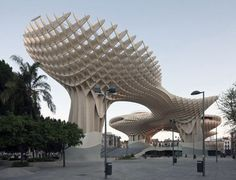 Metropol Parasol in Seville, Spain.  The world's largest wooden structure, and within is an archaeological museum, a farmers' market and panoramic rooftop walkways.