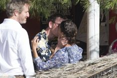 Sealed with a kiss... The handsome actor was seen cradling the gorgeous Jason Bourne actress' face as they shared a passionate kiss