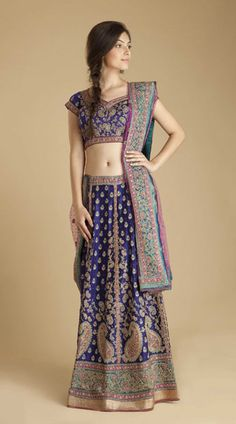 Royal blue and turquoise satin lehenga with zardozi embroidered paisley and floral designs lined in taffeta by Ritu Kumar $3,000