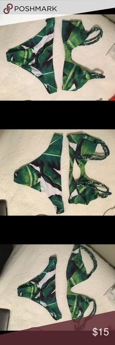 Palm leaf green two piece bathing suit bikini Palm leaf two piece bikini. Great condition. Never been worn. Selling because I ordered it online and it didn't quite fit my body type. Tags and panty liner still on Zaful Swim Bikinis