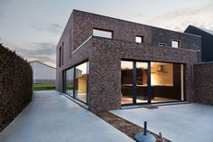 Modern brick home from Architecture Woning Brick Architecture, Garden Architecture, Interior Architecture, Modern Brick House, Modern House Design, Brick Facade, Facade House, Future Buildings, Brick Building