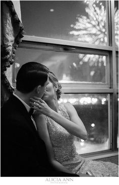 Bride and groom kiss at midnight with fireworks in the background - New Years eve wedding ideas, taken at the Bond Ballroom
