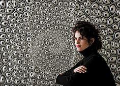 Neri Oxman is shown before a prototype for an environmental screen, Fibonacci's Mashrabiya, work inspired by fractal patterns found in natur...