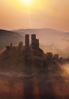 Corfe Castle sunrise, UK by Guy_Rogers, via Flickr