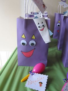 For a Dora Themed birthday party, I made these cute gift bags for the kids. Only need purple gift bags, googly eyes, and construction paper. Used construction paper for the eye brows mouth, and map. Outline the edges with a sharpie. For map, just glue a white piece and light blue piece of construction paper together-roll like a scroll then press flat. Attach to front of gift bag. Fill bags with fun Dora goodies from Party City!!